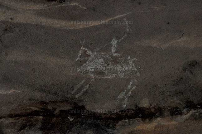 Archaeology- Bhimbetka Rock Shelters (India) Prehistoric Rock Painting of a men riding a horse in white color at Bhimbetka archaeological site, Raisen, Madhya Pradesh, India by Anil Sharma Fotography