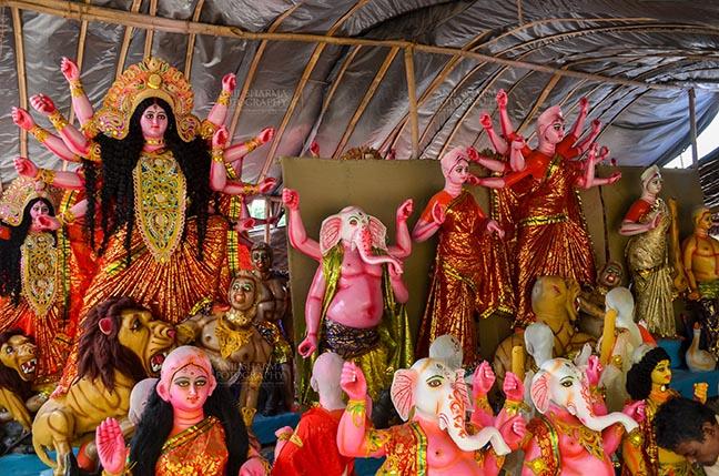 Festivals- Durga Puja Festival Durga Puja Festival, Noida, Uttar Pradesh, India- September 20, 2017: A row of Hindu God Lord Ganesha and Goddess Durga in a workshop at Noida, Uttar Pradesh, India. by Anil Sharma Fotography