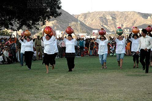 Festivals- Holi and Elephant Festival (Jaipur) Women's matkaa race at Holi and Elephant Festival at jaipur, Rajasthan (India). . by Anil Sharma Fotography