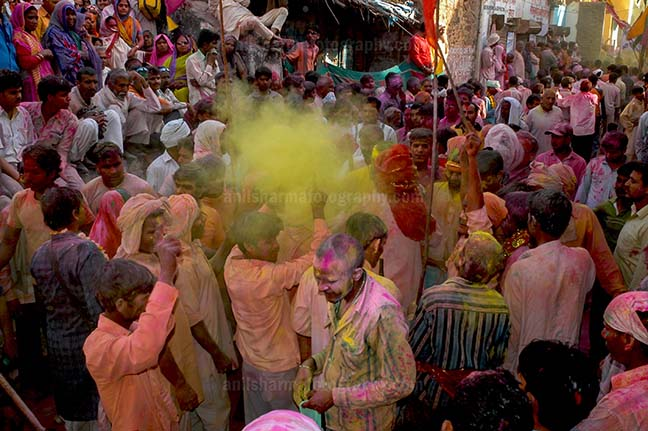 Festivals- Lathmaar Holi of Barsana (India) Lagre number of people gathered sprinkle colored powder, singing, dancing during Lathmaar Holi celebration at Barsana, Mathura, India. by Anil Sharma Fotography
