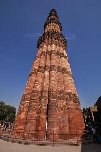 Monuments- Qutab Minar, New Delhi, India. Qutab Minar with verses from Holy Quran, the Tallest brick Minaret at Qutab Minar Complex, New Delhi, India. by Anil Sharma Fotography