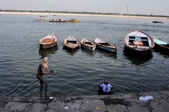 Travel- Varanasi the city of light (India) A Naga Sadhu Taking Bath in the Holy Ganges at Varanasi, Uttar Pradesh, India. by Anil Sharma Fotography
