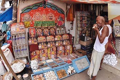 Festivals- Jagannath Rath Yatra (Odisha) Memento of Lord Jagannath, Balbhadra and Subhadra on display and an old customer at the shop near Lord Jagannath Temple at Puri, Odisha, India. by Anil Sharma Fotography