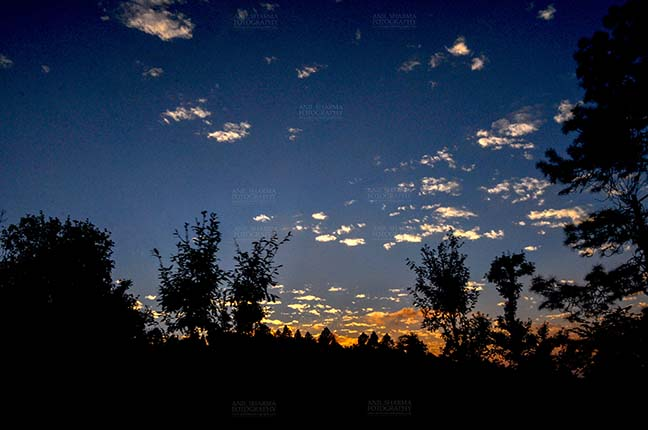 Clouds- Sky with Clouds (Almora) Clouds, Almora, Uttarakhand, India- November 4, 2016: After sunset, dark blue sky with small pathces of white clouds in the evening at Almora, Uttarakhand, India by Anil Sharma Fotography