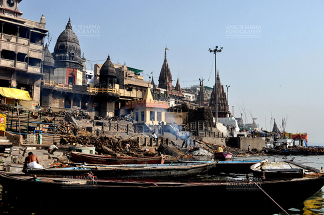 Travel- Varanasi the city of light (India) The Manikarnika Ghats at the bank of Holy River Ganges is the main Traditional Hindu cremation place where Hindus bodies are cremated at Varanasi, Uttar Pradesh, India. by Anil Sharma Fotography