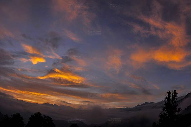 Clouds- Sky with Clouds (Tungnath) Clouds, Chopta Tungnath, Uttarakhand, India- July 29, 2011: Blue sky with orange clouds in the evening at Chopta Tungnath, Uttarakhand, India. by Anil Sharma Fotography