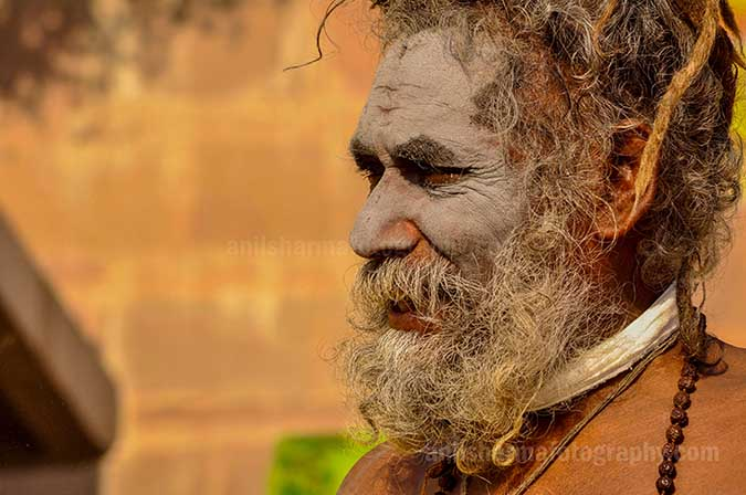 Culture- Naga Sadhu's (India) Smile on the face of an elderly Naga Sadhu at Ghat. by Anil Sharma Fotography