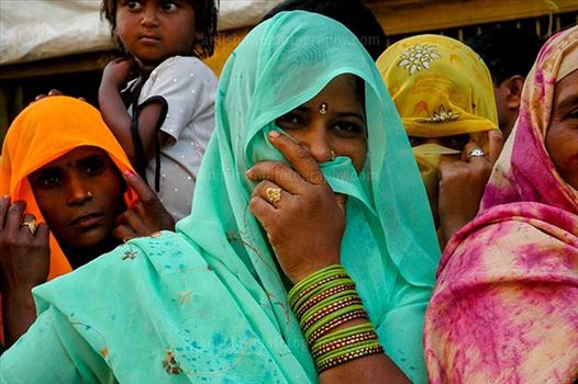 Festivals- Lathmaar Holi of Barsana (India) - A local women covering her face with her saree at Barsana, Mathura, Uttar Pradesh, India.