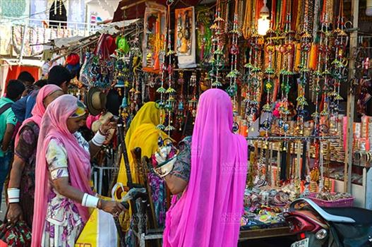 Fairs- Pushkar Fair (Rajasthan) - Pushkar, Rajasthan, India- January 16, 2018:  Rajasthani ladies shopping at shop during Pushkar Fair, Rajasthan, India.