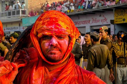 Festivals- Lathmaar Holi of Barsana (India) - A man daubed in color powder during Lathmaar Holi at Barsana, Mathura, Uttar Pradesh, India.