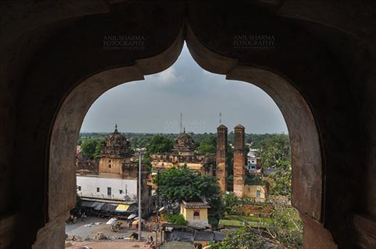 Monuments- Palaces and Temples of Orchha - Orchha, Madhya Pradesh, India- August 20, 2012: View from a carved window of Chaturbhuj temple, Orchha, Madhya Pradesh, India.