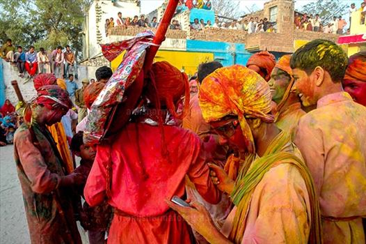 Festivals- Lathmaar Holi of Barsana (India) - Local people daubed in color powder during Lathmaar Holi celebration at Barsana, Mathura, Uttar Pradesh, India.
