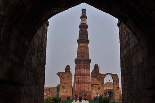 Monuments- Qutab Minar, New Delhi, India. - Qutab Minar, minaret tower with verses from Holy Quran at Qutab Minar Complex, New Delhi, India.