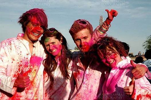Festivals- Holi and Elephant Festival (Jaipur) - Foreign tourists enjoying Holi and Elephant Festival at jaipur, Rajasthan (India).\r\n.