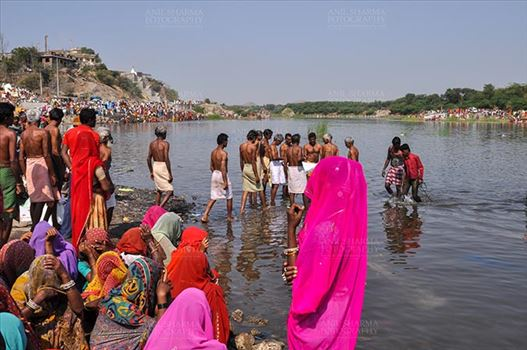 Fairs- Baneshwar Tribal Fair - Baneshwar, Dungarpur, Rajasthan, India- February 14, 2011: Devotees ready for the traditional ritual bath at the confluence of the rivers, Mahi and Som at Baneshwar, Dungarpur, Rajasthan, India