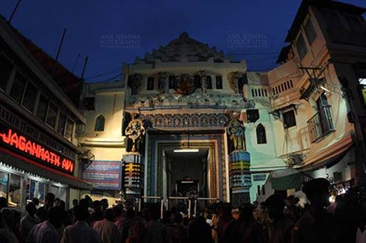 Festivals- Jagannath Rath Yatra (Odisha) - The Lion's Gate (Simhadwara) in front of the Jagannath Temple, decorated and dimly lit, for Jagannath Rath Yatra festival at Puri, Odisha, India.