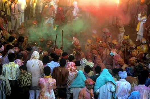 Festivals- Lathmaar Holi of Barsana (India) - Lagre number of people gathered sprinkle colored powder, singing, dancing during Lathmaar Holi celebration at Barsana, Mathura, India.