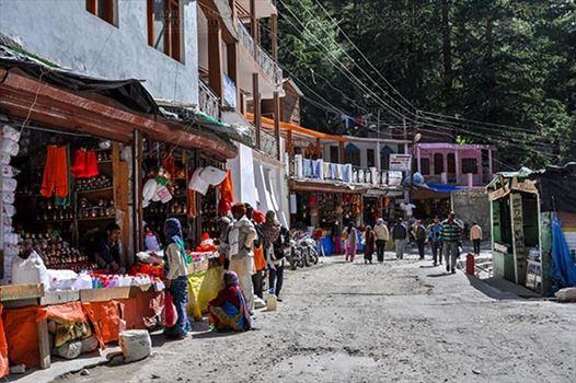Travel- Gangotri (Uttarakhand) - Gangotri, Uttarakhand, India- May 13, 2015: Main Bazaar of Gangotri, tourists buying devotional objects from the shops Gangotri, Uttarkashi, Uttarakhand, India.