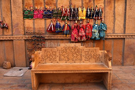 Festivals- Jaisalmer Desert Festival, Rajasthan - Rajasthani Puppets hanging on the wall.