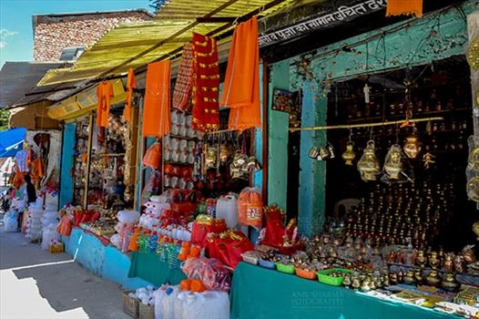 Travel- Gangotri (Uttarakhand) - Gangotri, Uttarakhand, India- May 13, 2015: shopkeepers selling devotional objects, necklaces, beads, jewelry, gemstones, bracelets, earrings, bangles, and items for religious ceremonies at Gangotri, Uttarkashi, Uttarakhand, India.