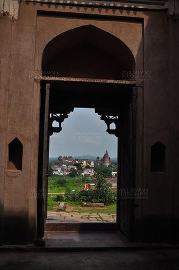 Monuments- Palaces and Temples of Orchha - Orchha, Madhya Pradesh, India- August 20, 2012: View from a carved window of Laxmi Temple, Chaturbhuj temple is seen in the distance, Orchha, Madhya Pradesh, India.