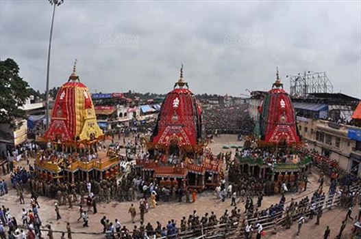 Festivals- Jagannath Rath Yatra (Odisha) - The chariots of Lord Jagannath, Balbhadra and Subhadra traditionally decorated, parked in front of the Jagannath temple at Puri, Odisha, India.