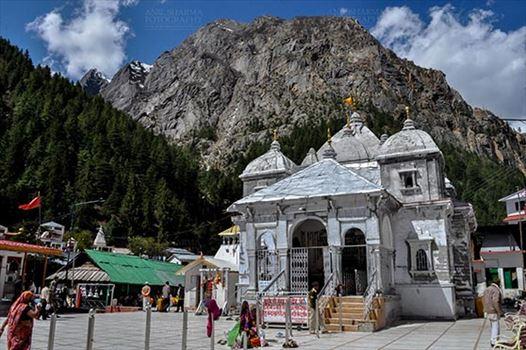 Travel- Gangotri (Uttarakhand) - Gangotri, Uttarakhand, India- May 13, 2015: Snow peaks, blue sky and Devotees at Goddess Ganges Temple, Gangotri, Uttarkashi, Uttarakhand, India.