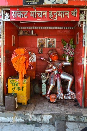 Fairs- Pushkar Fair (Rajasthan) - Pushkar, Rajasthan, India- January 16, 2018: A small temple of Hindu God Hanuman at Holy Pushkar Sarovar Ghat at Pushkar, Rajasthan, India.