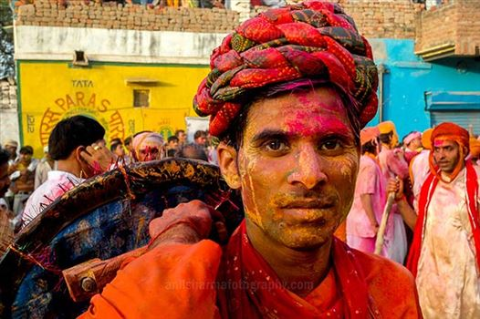 Festivals- Lathmaar Holi of Barsana (India) - A man daubed in color powder smiles as he celebrates lathmaar Holi at Barsana.