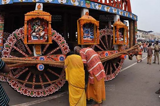Festivals- Jagannath Rath Yatra (Odisha) - Devotee's praying to the idols assembled on the chariot for Jagannath Rath Yatra festival at Puri, Odisha, India.