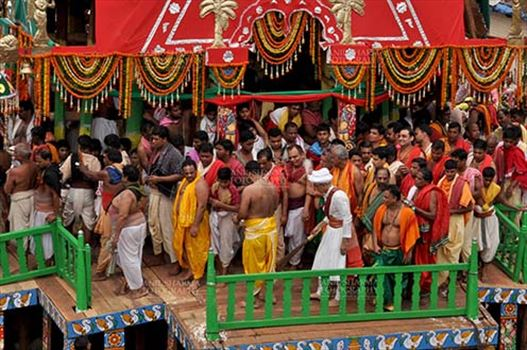 Festivals- Jagannath Rath Yatra (Odisha) - The religious custom of Gajpati king wearing the outfit of a sweeper and sweeping the chariot before the commencement of the rath yatra, for Jagannath Rath Yatra festival at Puri, Odisha, India.