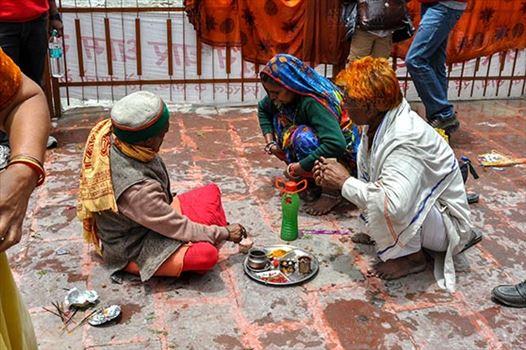Travel- Gangotri (Uttarakhand) - Gangotri, Uttarakhand, India- June 14, 2013: A Hindu family making a religious ritual at Goddess Ganga Temple, Gangotri, Uttarakhand, India.