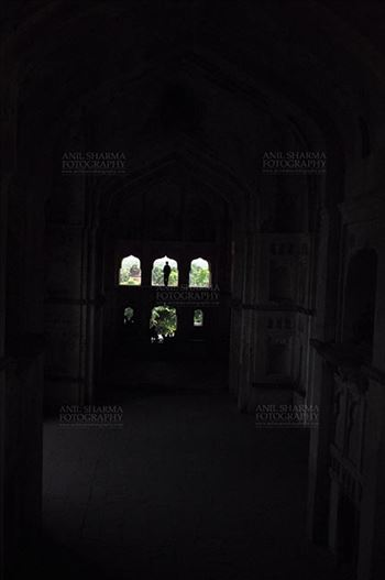 Monuments- Palaces and Temples of Orchha - Orchha, Madhya Pradesh, India- August 20, 2012: Silhouette of a woman in Chaturbhuj Temple at Orchha, Madhya Pradesh, India.