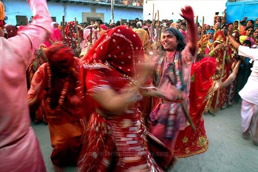 Festivals- Lathmaar Holi of Barsana (India) - Some women dancing some holding bamboo sticks, during \