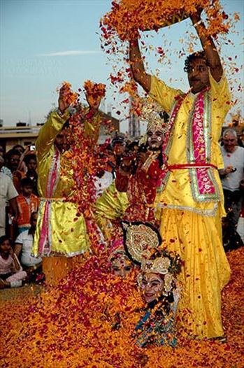 Festivals- Holi and Elephant Festival (Jaipur) - People sprinkling rose and merigold petals on Radha-Krishana at Holi and Elephant Festival at jaipur, Rajasthan (India).\r\n.