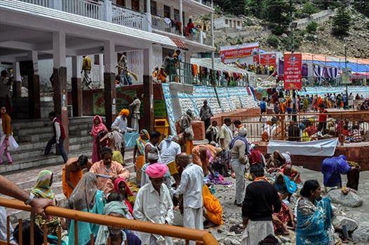 Travel- Gangotri (Uttarakhand) - Gangotri, Uttarakhand, India- June 14, 2013:  Devotees at Goddess Ganges Temple to perform prayer ritual and to have holy dip into Bhagirathi River at Gangotri, Uttarkashi, Uttarakhand, India.