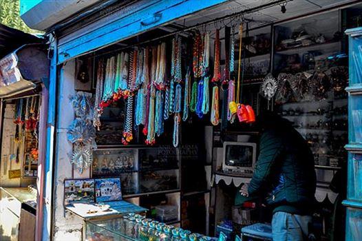 Travel- Gangotri (Uttarakhand) - Gangotri, Uttarakhand, India- May 13, 2015: Shops to buy necklaces, beads, jewelry, gemstones, bracelets, earrings, bangles, and devotional objects for religious ceremonies at Gangotri Bazaar, Uttarkashi, Uttarakhand, India.