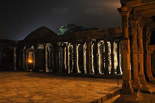 Monuments- Qutab Minar in Night, New Delhi, India. - The beauty of Hindu temple columns with stone carving in the courtyard of Quwwat-Ul-Islam mosque in night at Qutub Minar Complex, Mehrauli , New Delhi, India.