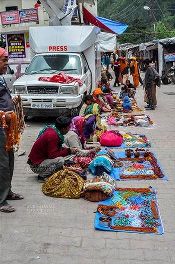 Travel- Gangotri (Uttarakhand) - Gangotri, Uttarakhand, India- June 14, 2013: Local people selling beads, jewelry, gemstones, bracelets, earrings, bangles, on the road side at Gangotri, Uttarkashi, Uttarakhand, India.