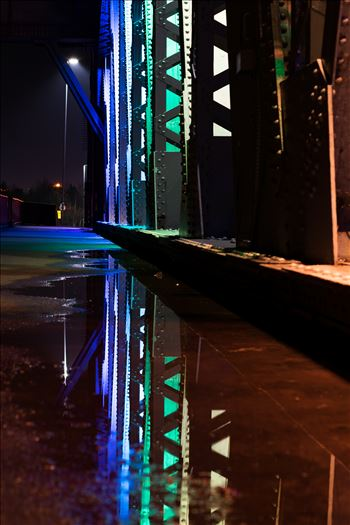 Newport Bridge Rainbow Lights Puddle Refrlection by AJ Stoves Photography