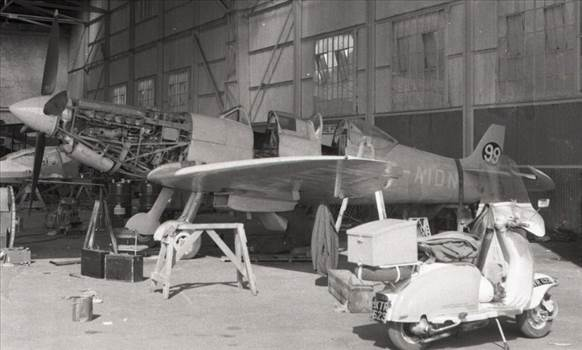 Repairs to aTwin seat WWII Fighter plane 99 AIDN   Moped K…   Flickr.png by Frank Bell