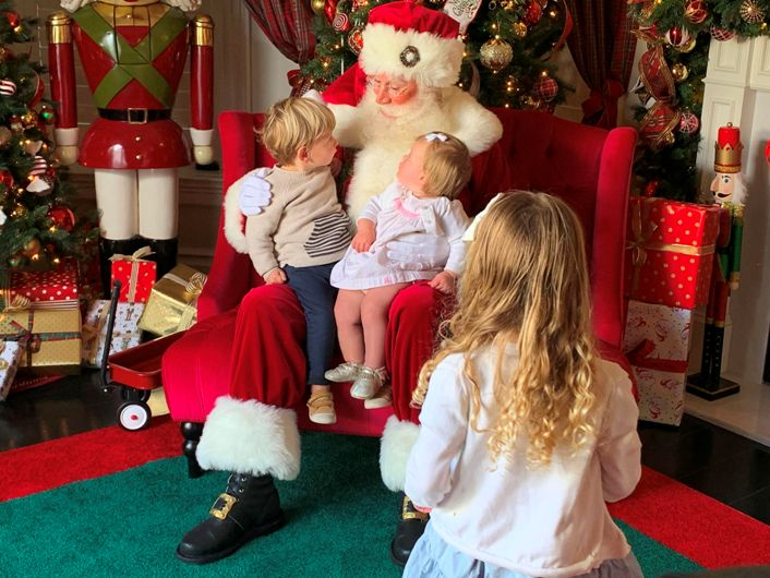 red sled santa with childreen.jpg  by Christmasthenandnow