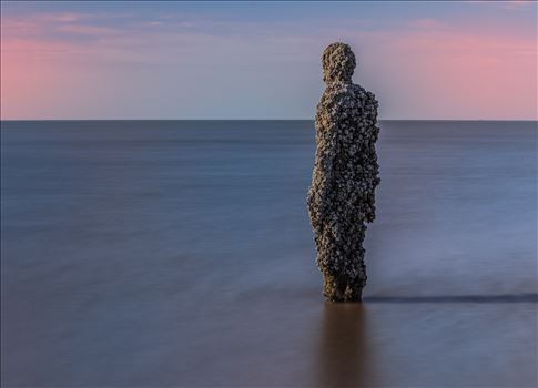 Anthony Gormley Statue on Crosby Beach - Long Exposure shot at Another Place that is a series of statues by Anthony Gormley on Crosby Beach near Southport.