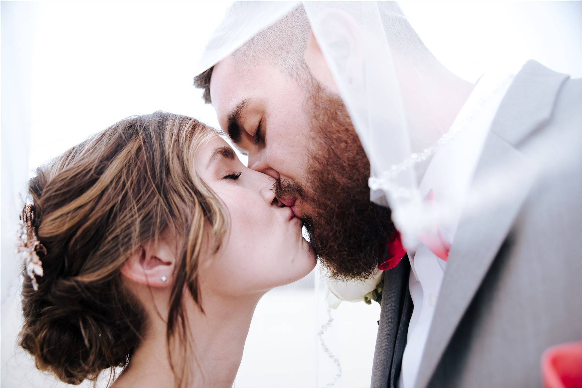 FW-9090.jpg Romantic wedding in the sand on Grover Beach in California.  Barefoot with surfboards and driftwood, tent and ceremony set up by Beach Butlerz, wedding photography by Mirror's Edge Photography.  Romantic Bride and Groom under the veil by Sarah Williams