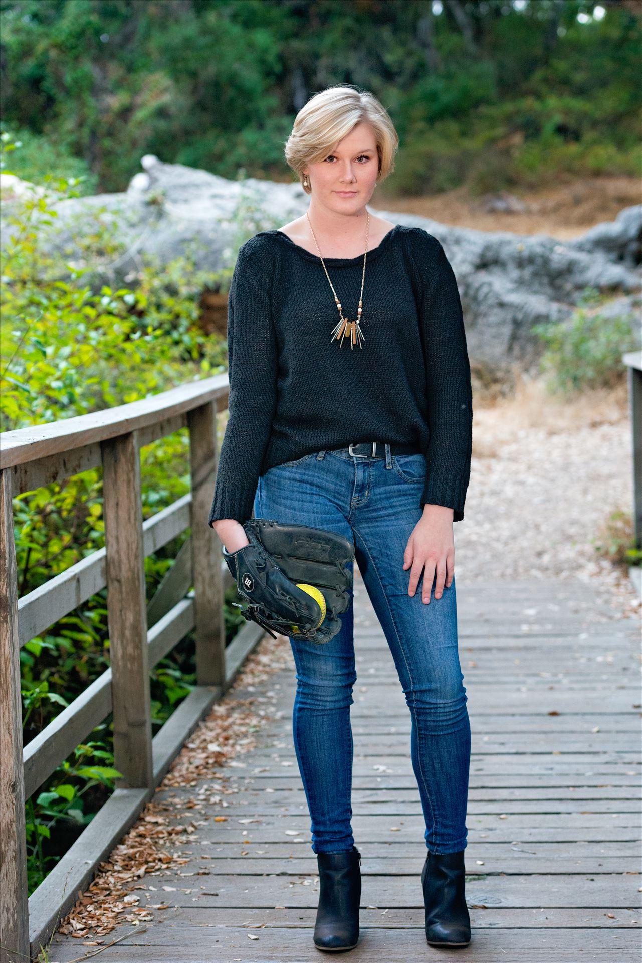 Ariel Ingram Senior Portraits 26 Senior Portrait Session 2018 at Los Osos Oaks Reserve.  San Luis Obispo and Central Coast Senior Portrait photographer Mirror's Edge Photography. Senior on bridge with softball prop by Sarah Williams