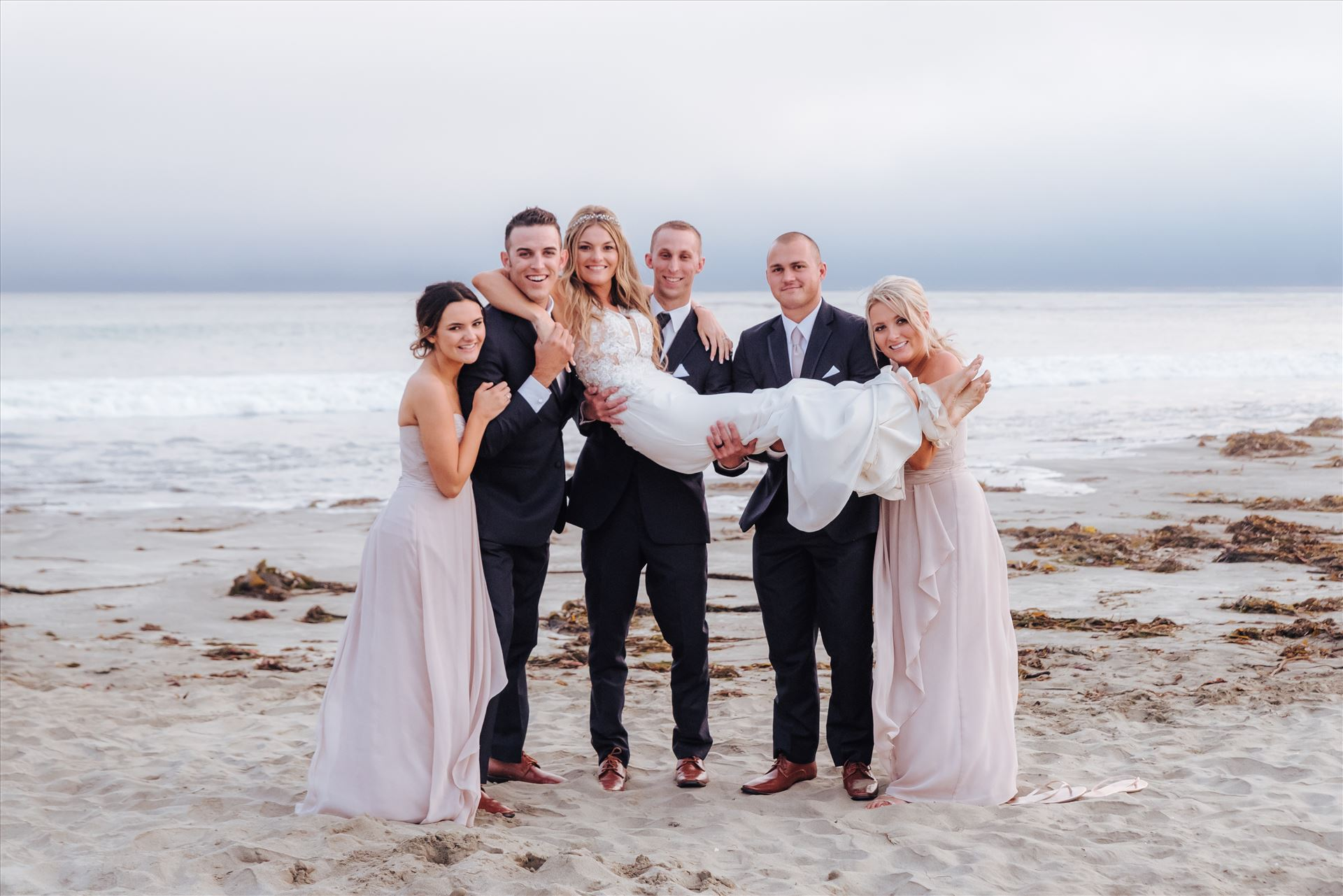Courtney and Doug 66 Mirror's Edge Photography, San Luis Obispo Wedding Photographer captures Cayucos Wedding on the beach and bluffs in Cayucos Central California Coast. Wedding Party Bridal Party at the Beach by Sarah Williams