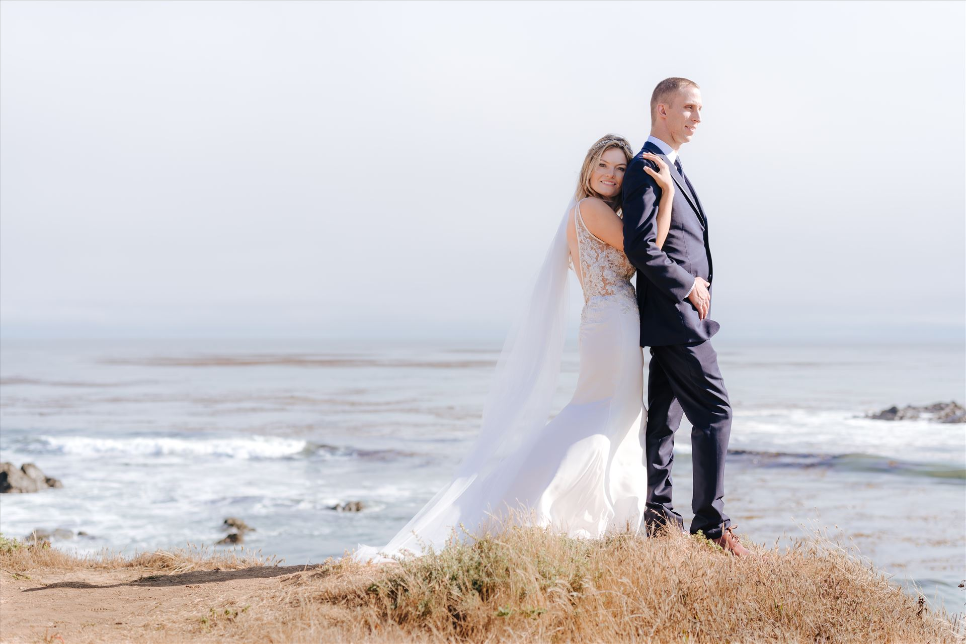 Courtney and Doug 55 Mirror's Edge Photography, San Luis Obispo Wedding Photographer captures Cayucos Wedding on the beach and bluffs in Cayucos Central California Coast. Bride and Groom overlooking the ocean by Sarah Williams