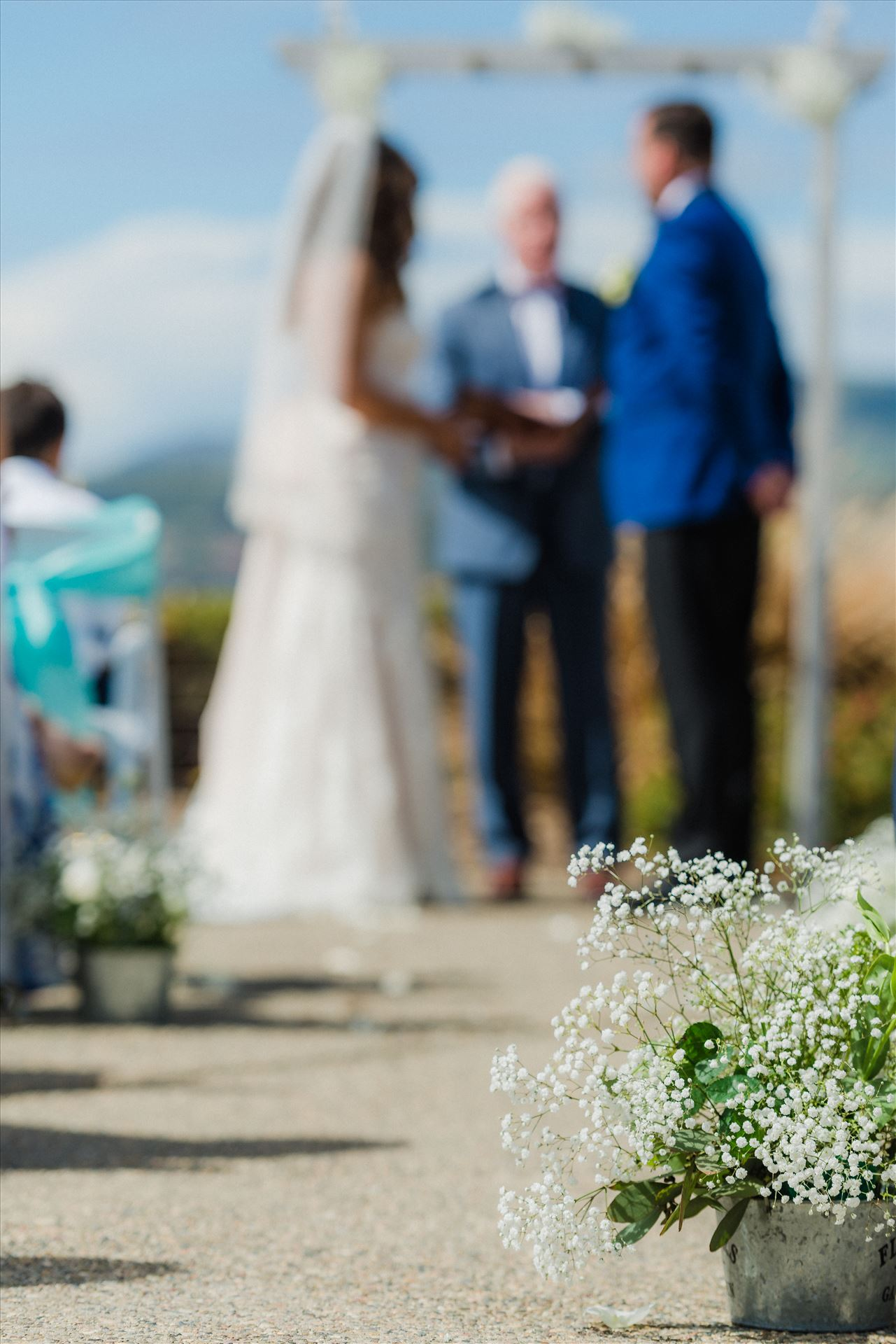 Candy and Christopher 17 Wedding at Dolphin Bay Resort and Spa in Shell Beach, California by Sarah Williams of Mirror's Edge Photography, a San Luis Obispo County Wedding Photographer. Down the aisle at Spyglass by Sarah Williams