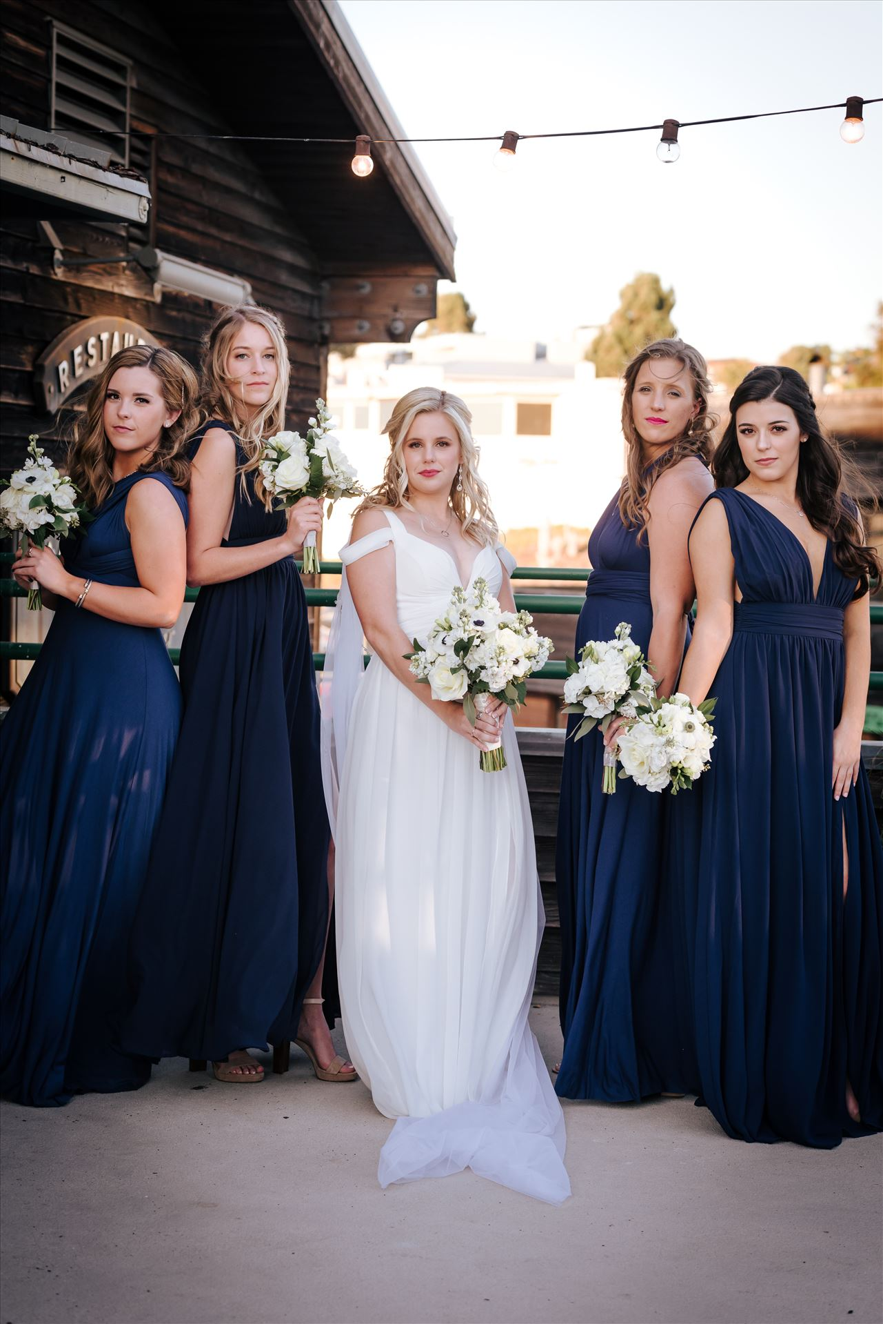 FW-8206.JPG Sarah Williams of Mirror's Edge Photography, a San Luis Obispo Wedding and Engagement Photographer, captures Ryan and Joanna's wedding at the iconic Windows on the Water Restaurant in Morro Bay, California.  Bride and Bridesmaids outside of Windows. by Sarah Williams