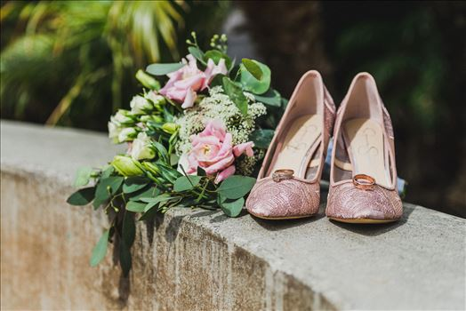 Candy and Christopher 02 - Wedding at Dolphin Bay Resort and Spa in Shell Beach, California by Sarah Williams of Mirror\u0027s Edge Photography, a San Luis Obispo County Wedding Photographer. Rings and shoes at Dolphin Bay Resort